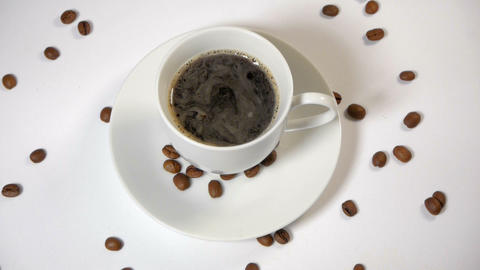 Coffee cup and beans on a white background Footage