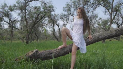 Girl in white dress walking Footage