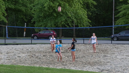Teenagers enjoying game beach volleyball in park Footage