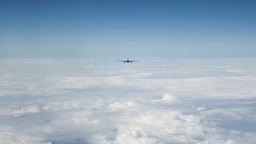 Passenger aircraft above the clouds 3 CG動画素材
