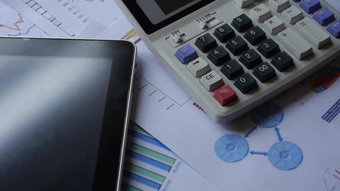 Rotating Of Calculator & Tablet Pc With Business G stock footage