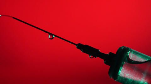 Syringe Needle Vaccine Dripping Close Up Footage