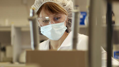 Female Face In Medical Mask In Lab stock footage