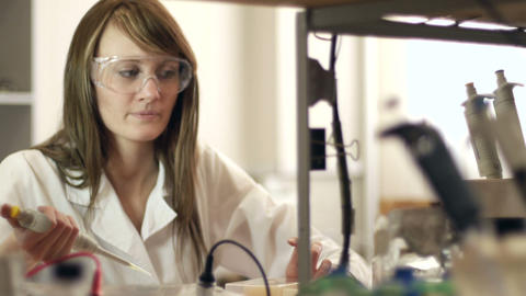 Academic Girl Doing Tests in Laboratory Footage