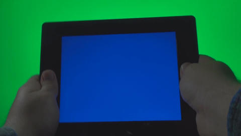 Hands Using A Blue Screen Tablet PC On A Green Scr Footage