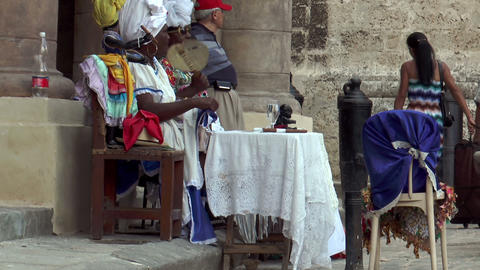 female voodoo priests preparing their table in hav Footage