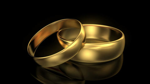 Zoom in wedding rings on black background Animation