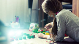 Cute girl playing with bricks Footage