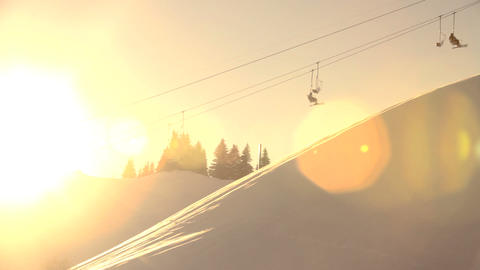 Skiers Ride Chairlift Across Frame, Silhouetted Ag stock footage