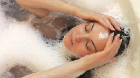 Relaxed Woman Lying In Bubble Filled Bath Washing  stock footage