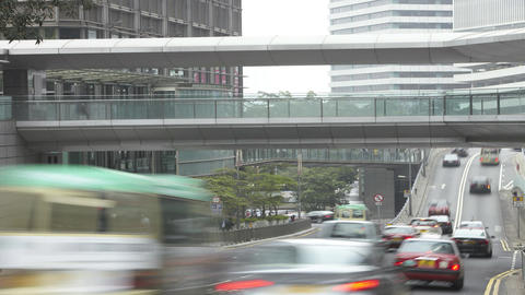 Traffic speeds along road as commuters use pavemen Footage