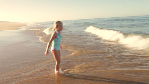 Young Girl Standing In Sea As Waves Break Footage