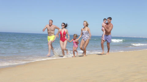 Multi Generation Family Running Along Beach Footage