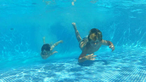 Two Boys Jumping Into Pool Then Swims Underwater T Footage