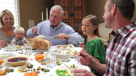 Grandfather Carving Turkey At Family Thanksgiving Live Action