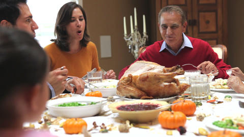 Multi Generation Family Enjoying Thanksgiving Meal Live Action