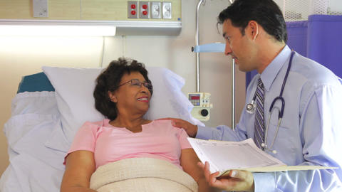 Doctor Talking To Senior Female Patient In Hospita stock footage