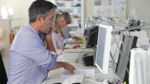 Man Office At Desk Using Mobile Phone And Computer Footage