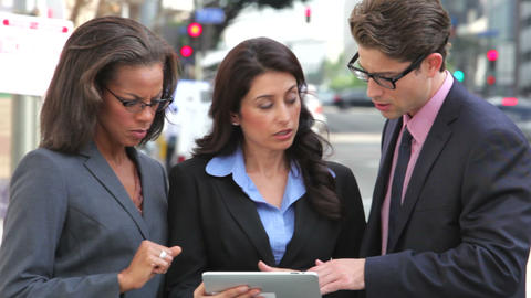Businesspeople Using Digital Tablet Outside Footage