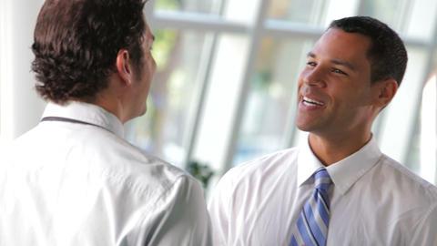 Two Businessmen Talking In Office Footage