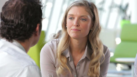 Businessman And Businesswomen Talking In Office stock footage