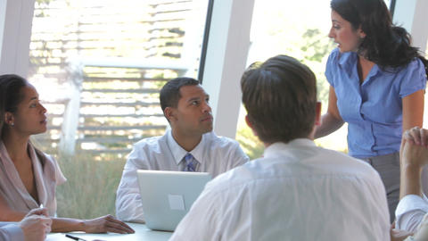 Group Of Businesspeople At Table Having Meeting stock footage