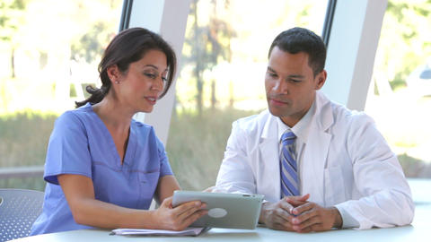 Medical Staff Review Information On Digital Tablet stock footage