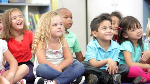 Group Of Elementary Age Schoolchildren Sitting On  Footage