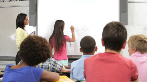 Pupil Standing At Front Of Class Writing On Board Footage