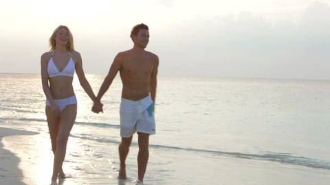 Romantic Couple Walking On Beautiful Tropical Beac Stock Video Footage