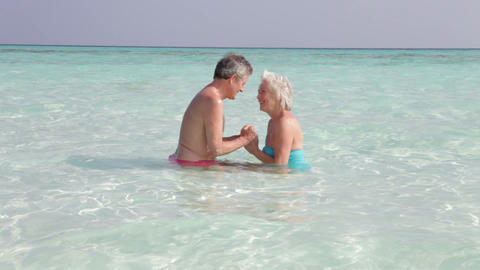 Senior Couple Relaxing In Tropical Sea Footage