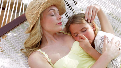 Mother And Daughter Relaxing In Beach Hammock Footage