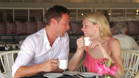 Young Couple Drinking Coffee In Restaurant stock footage