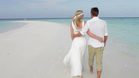 Rear View Of Couple Walking Along Beach At Wedding, Live Action