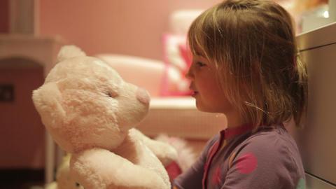 Girl Giving Teddy Bear Hug Whilst Wearing Pajamas Footage