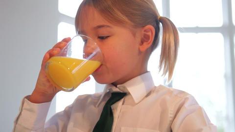 Girl Wearing School Uniform Drinking Glass Of Oran Live Action