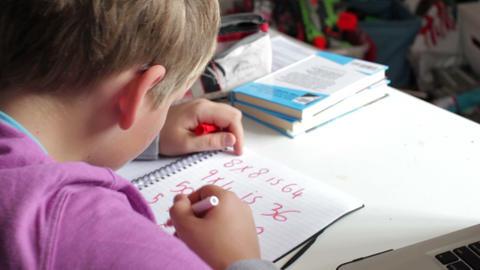 Boy Doing Math's Homework In Bedroom Footage