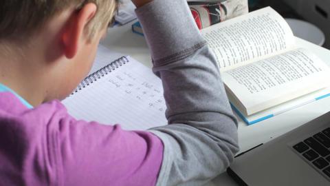 Boy Struggling With Written Homework In Bedroom Footage