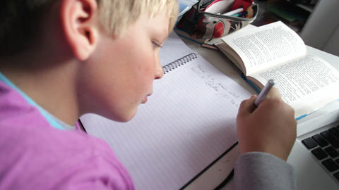 Boy Doing Written Homework In Bedroom Footage