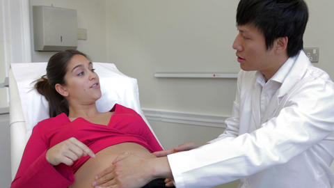 Pregnant Woman Being Given Ante Natal Check By Doc Live-Action