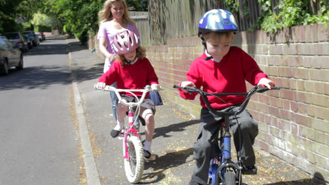 Children Riding Bikes On Their Way To School With Footage