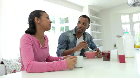 Couple Having Breakfast In Kitchen Together Live Action