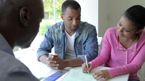Young Black Couple Meeting With Financial Advisor  Footage