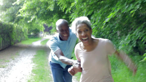 Mature African American Couple Running Along Count Footage