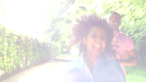 Young African American Couple Running Along Countr Footage