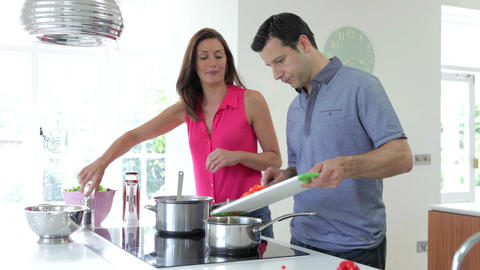 Hispanic Couple Cooking Meal At Home Footage