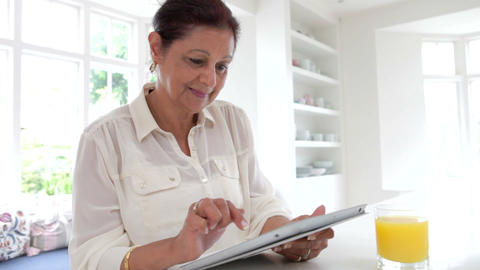 Senior Indian Woman Using Digital Tablet At Home stock footage
