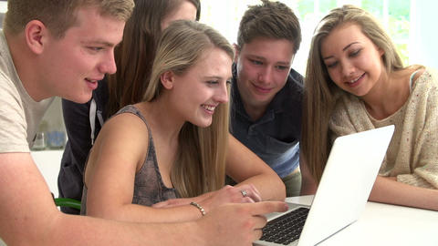 Group Of Teenagers Gathered Around Laptop Together Footage