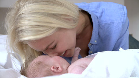 Mother Rubbing Noses With Baby In Bed Live Action
