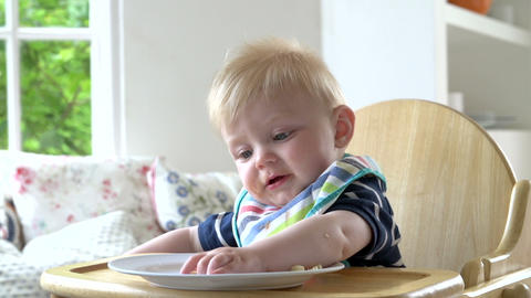 Baby Boy Eating Meal In In High Chair Footage
